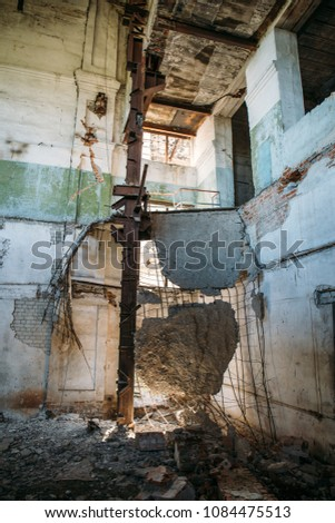 Ruins of industrial building interior after disaster or war or earthquake. Workshop with collapsed floors, devastation and consequences of disasters, toned #1084475513