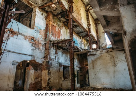 Ruins of industrial building interior after disaster or war or earthquake. Workshop with collapsed floors, devastation and consequences of disasters, toned #1084475516
