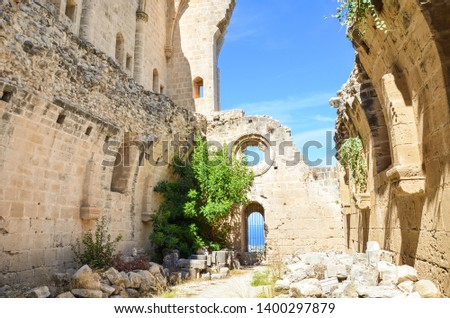 Ruins of medieval Bellapais Abbey in Turkish Northern Cyprus taken on a sunny day with blue sky. The historical Cypriot monastery is a popular tourist sight.
