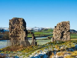 Ruins of Medieval 11th century Clun Castle in England, UK, built by William the Conqueror and view over Shropshire Hills