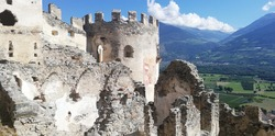 Ruins of Montechiaro Castle in Val Venosta, with mighty walls and a large tower open to the blue sky