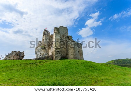 Ruins Of Old Medieval Castle And White Clouds On Blue Sky