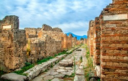 Ruins of Pompeii with Mount Vesuvius, near Naples. One of the main tourist attractions in Italy.