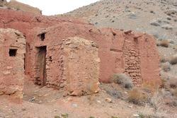 Ruins of red mud-brick house in Abyaneh, Iran.