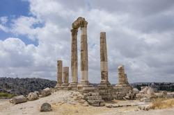 Ruins of roman Temple of Hercules on the Amman citadel with city view. Jordan