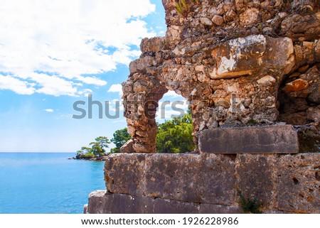 Ruins of the ancient city of Phaselis, Turkey. Roman ancient ruins on sea background. Phaselis Antik Kenti Antalya Stock fotó ©