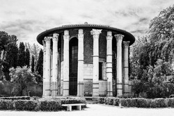Ruins of the ancient Temple of Hercules Victor or Hercules Olivariu in Piazza Bocca della Verita in Rome, Italy in black and white