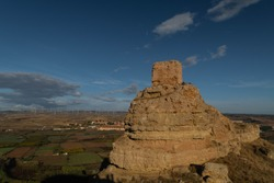 Ruins of the Arab castle at Maria de Huerva near Zaragoza early in the morning with the windmills of La Muela in the background
