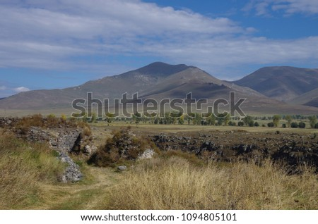 Ruins of the Armenian medieval fortress Lori Berd near Stepanavan with mountains at background, Armenia #1094805101