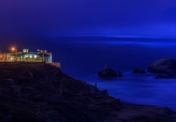 Ruins of the Sutro baths at Lands End on Ocean Beach, the Cliff house in the background in San Francisco, California with Seal Rock and Pacific Ocean