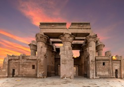 Ruins of the Temple of Kom Ombo in the Nile river at sunset, Egypt