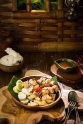rujak cingur, a traditional meals made from a mixture of vegetables, fruits, and beef snouts.