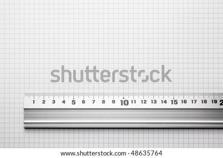 Ruler aligned to a scaled paper. For showing actual size of a object