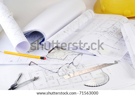Ruler, eraser, glasses and a pencil on the floor plan