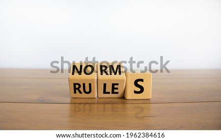 Rules or norms symbol. Turned cubes and changed the word 'norms' to 'rules'. Beautiful wooden table, white background, copy space. Business and rules or norms concept. Photo stock ©