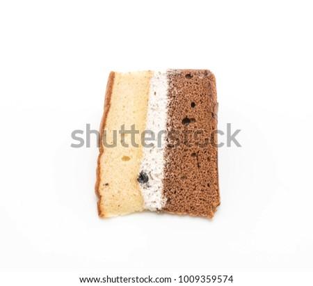 rum raisin and chocolate chiffon cake isolated on white background #1009359574