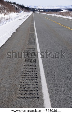 Rumble Strips on Alaska Highway in Winter