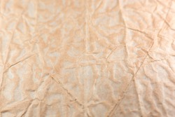 Rumpled beige background. Real texture of the wrapping texture.