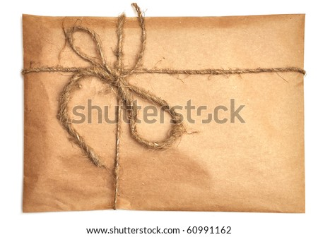 rumpled brown paper envelope tied with twine