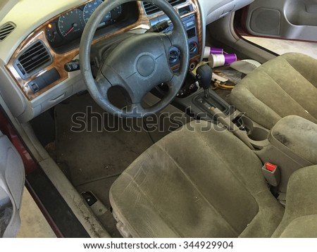 run down car interior car cabin cluttered with fast food cups and trash showing run down fabric. Black Bedroom Furniture Sets. Home Design Ideas