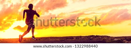 Run sport athlete running in sunset - Silhouette of fitness girl jogging on trail road with orange sky background. Fit woman exercise lifestyle. Active people training panoramic banner.