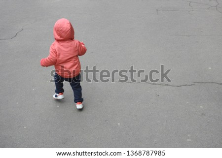 Runaway toddler. Toddler runs across the road. Kid running away
