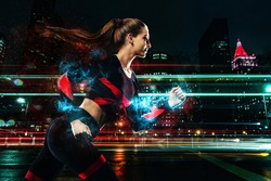 Runner athlete, Fitness and sport motivation. Strong athletic woman sprinter, running in the night city. Girl model wearing sportswear outfit.