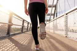 Runner athlete running on sport trail.  Fitness in the nature. Morning exercise with beautiful, sport woman. Woman fitness jogging, workout wellness concept.