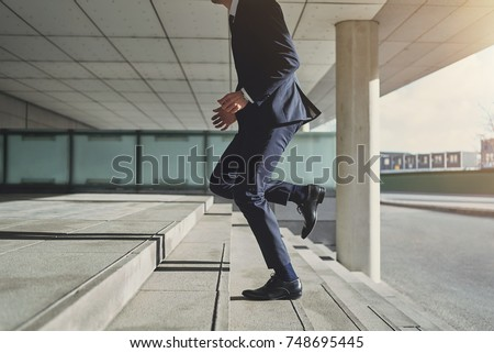 Runner businessman hurrying to office. Horizontal outdoors shot #748695445