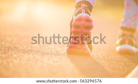 runner feet running on road...