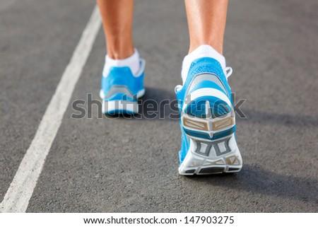 Runner Feet Running on Stadium Closeup - outdoor shot