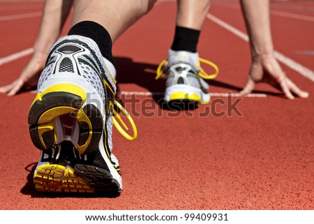 Runner in stadium waits for his start
