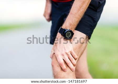 Runner leg and muscle pain during running training outdoors in summer nature, sport jogging physical injury, workout. Health and fitness concept