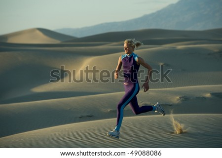 Runner on dunes in a valley