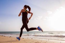 Runner on the beach at dawn.