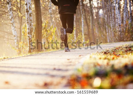 Runner run in park during autumn