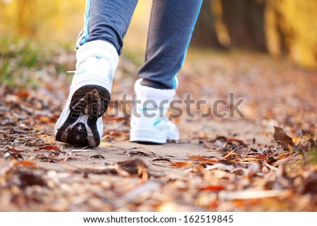 Runner running on the road. Close up running feet in trainers. Healthy lifestyle, fitness, jogging, active, young concept.