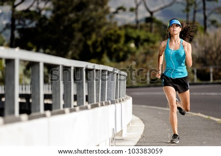 runner running over a bridge alone the road, training for fitness and marathon healthy lifestyle athlete with headphones