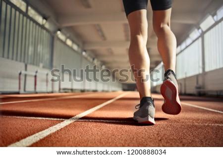 Runner's legs in motion. #1200888034