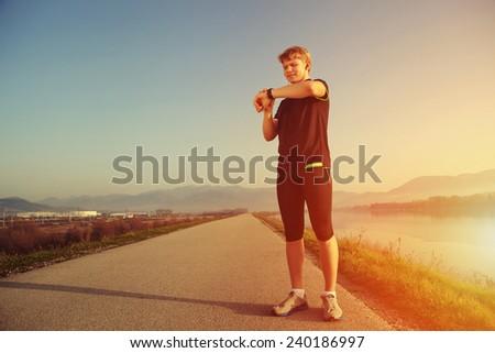 Runner start his watch before training