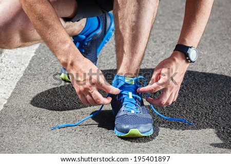 Runner trying running shoes getting ready for run. ストックフォト ©