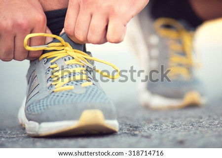 Runner tying shoelaces on sneakers #318714716