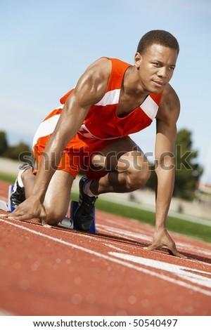 Runner Waiting in Starting Block