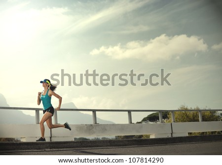 Runner woman exercise outdoors panorama with copyspace in vintage tone - stock photo