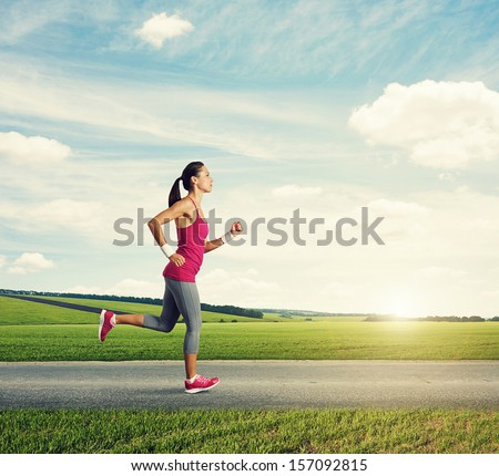runner woman jogging in countryside