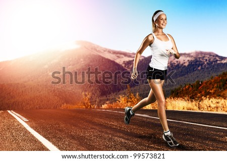 Runner - woman running outdoors on road