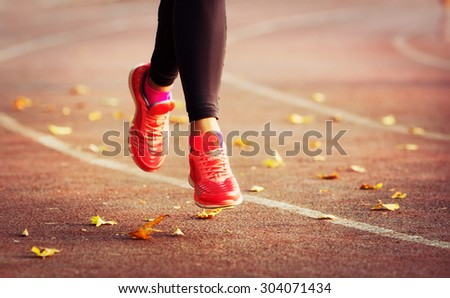 Runner - woman training.Female fitness concept