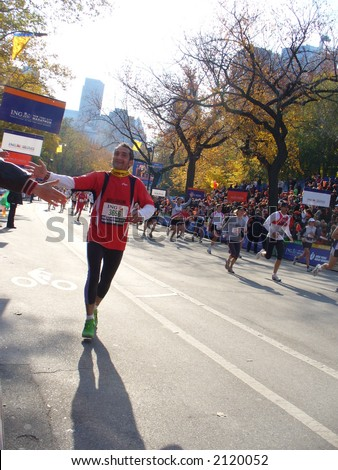 Runners are elated as they approach the finish line of the 2006 ING New York City Marathon