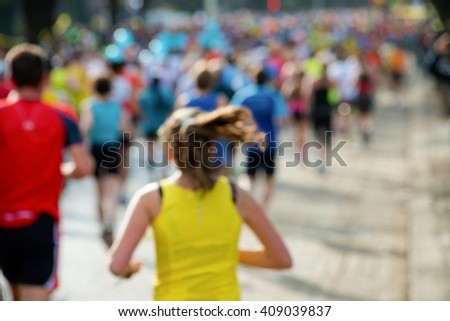 runners in marathon woman abstract, blurry #409039837