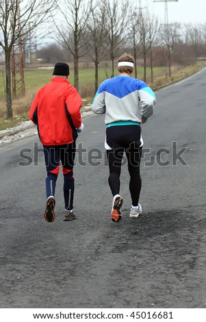 Runners while training for a competition in winter